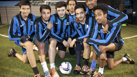 Sixth form football team at St Augustine's launching a kick it out campaign by wearing rainbow laces