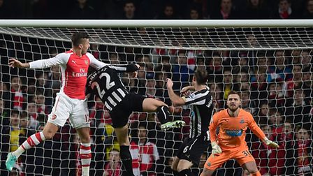 Arsenal's Olivier Giroud scores with a header against Newcastle