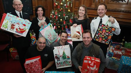 Police officers and council members collect all presents from the Christmas tree project at Islingto