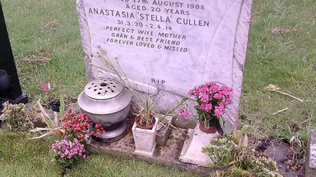 The grave after the flowers were torn out