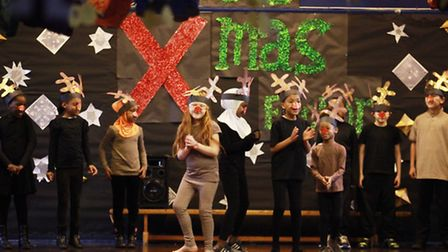 Year six pupils from Pooles Park Primary School perform at the Christmas nativity