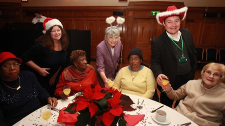 Councillors Angela Picknell, left, Janet Burgess and Andy Hull serves some drinks to pensioners in t