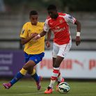 Arsenal's Ainsley Maitland-Niles holds off challenge from Derby County's Alefe Santos