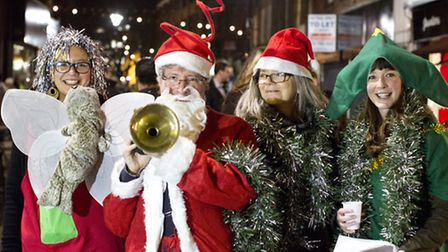 The Big Wheel theatre company sing some carols at the Exmouth Market's Christmas Party Pic: Isabel I