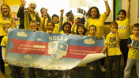 Pupils and staff at Robert Blair Primary School celebrate the launch of their solar panel fundraisin
