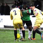 Hendon striker Leon Smith tries to squeeze between two Wingate players on Saturday. Pic: Andrew Alek