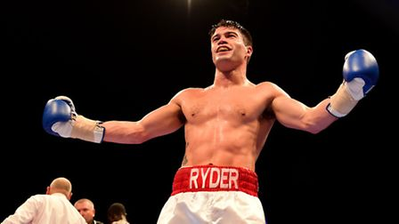 John Ryder celebrates beating Theophilus Tetteh during their Middleweight fight at the O2 Arena, Lon