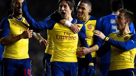Arsenal's Tomas Rosicky celebrates with his team-mates (Photo by Mike Hewitt/Getty Images)
