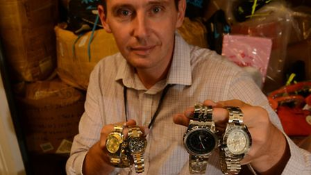 Andrew Clooney, senior prosecutor at Brent Council, with some of the seized watches