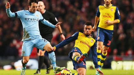 Arsenal's Francis Coquelin tackles Manchester City's David Silva (Photo by Alex Livesey/Getty Images