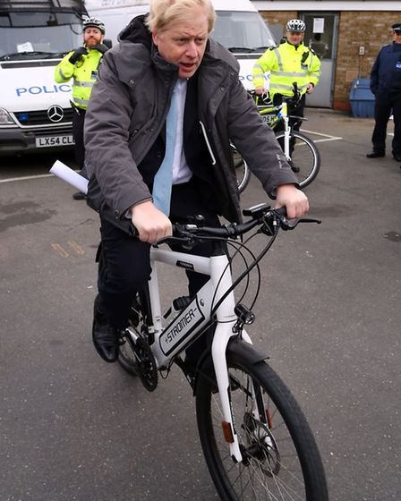 Mayor of London Boris Johnson tries an electric bike as he meets with officers from the Metropolitan
