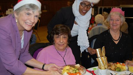 Cllr Janet Burgess and Cllr Rakhia Ismail serve food to pensioners