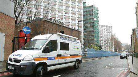 A police van outside Stelfox House in Islington, London, where a murder investigation has been launc