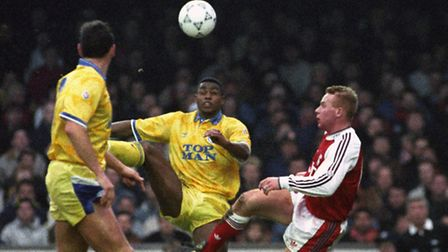 Arsenal's Perry Groves battles for the ball with Leeds United's Chris Fairclough (c) and Chris Whyte