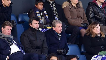 England manager Roy Hodgson (centre) watches from the stands at Loftus Road.
