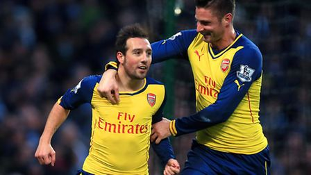 Arsenal's Santi Cazorla (left) celebrates scoring his side's first goal of the game from the penalty