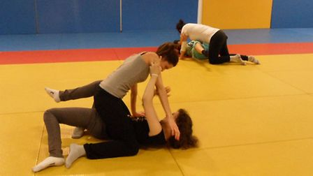 Some of Sev's students learn how to fight back against attackers on the floor, photo credit: Sev Nec