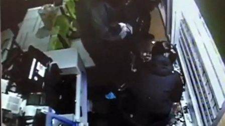 The suspects in helmets shoved cigarettes down their trousers and into bags