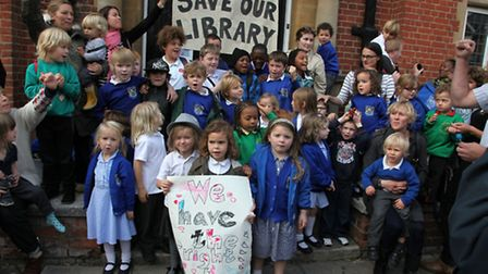 Young campaigners outside the library