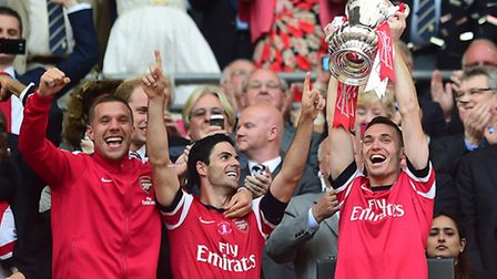 Arsenal's Thomas Vermaelen lifts the FA Cup