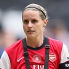 Kelly Smith of Arsenal Ladies displays the FA Cup after their victory over Everton in the 2014 final