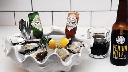 Oysters how they should be; on ice, with shallots and vinegar, Tabasco and an Islington-brewed oyste