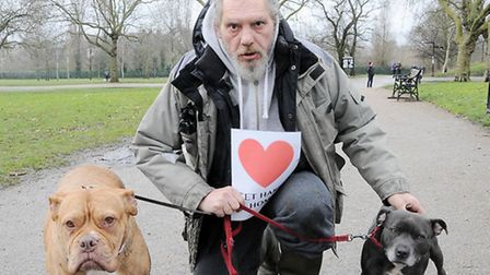 Heartbroken: Kyriacos Kyriacou with his two other dogs Boom Boom and Duchess Pic: Dieter Perry