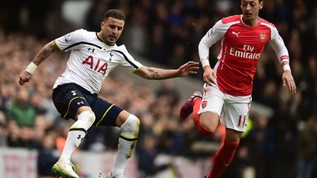Tottenham Hotspur's Kyle Walker and Arsenal's Mesut Ozil. Picture: PA/Adam Davy