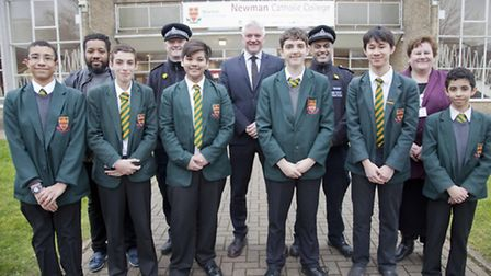 Staff and police with pupils from Newman Catholic College who have succeeded in getting the highest