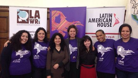 Gabriela Quevedo, second from left, with staff and volunteers of LAWA