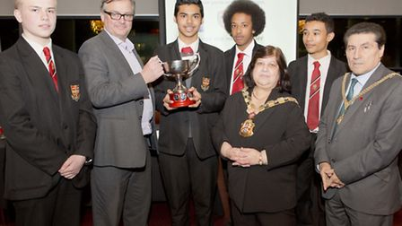 Fast Show star Charlie Higson congratulates the winning team from the Central Foundation boys School