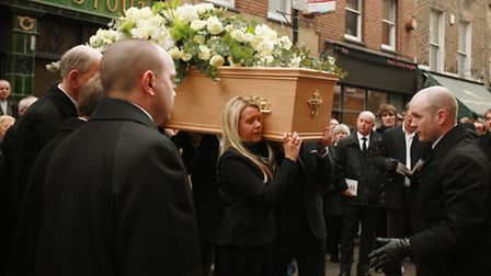 Henry Hicks' coffin is carried in to The Holy Redeemer Church in Exmouth Market