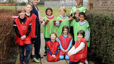 Cllr Janet Burgess and local children celebrate the renovated pitches at Tufnell Park