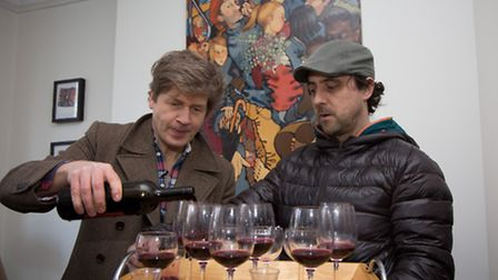 Leo Johnson, left, pouing a a glass of his organic red wine with John Smith