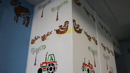 Jo White's stencil artworks in the hallway of Turnpike House