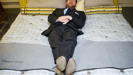 Ed Vaizey, minister for culture and the digital economy, taking a lie down at a bespoke bed company