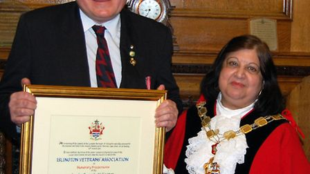 Mark Samson of the Islington Veterans Association receiving Freedom of the Borough from Mayor Theres