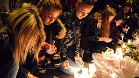 Alan Cartwright candlelit memorial event on Calendonian Road 06.03.15. Tribute candles are lit in me