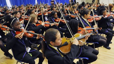 Pic of students playing their instruments at Highbury Grove School, Highbury New Park, N5. Must cred
