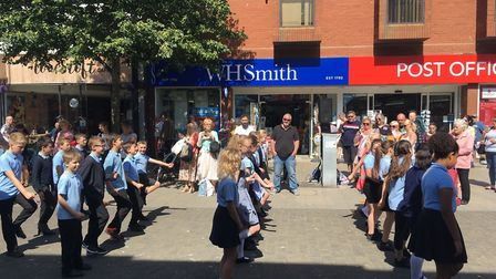 Pupils from St Margaret's Primary Academy surprised shoppers with a flashmob on London Road North in