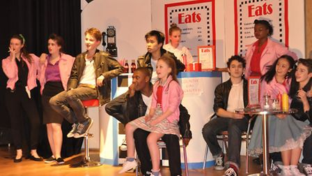 Pupils from Queens Park Community School perform Grease, the musical