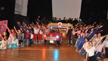 Pupils from Queens Park Community School perform Grease the musical,