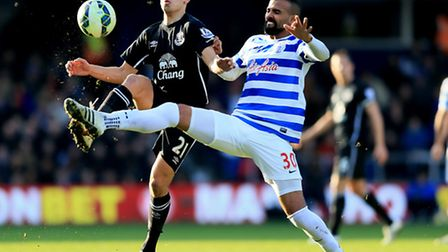 Queens Park Rangers' Sandro (right) and Everton's Leon Osman battle for the ball at Loftus Road.