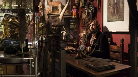 Dinner is served amid Mr Wynd's freakish, yet intruiging, collection Pic: Anthony Lycett