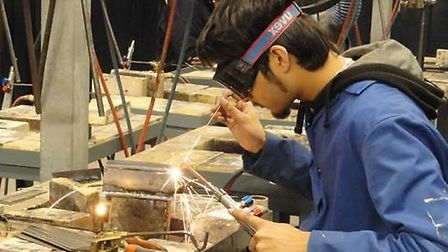 Mohammed Saleh competed in a welding skills competition at a previous college event