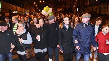 Alan Cartwright candlelit memorial event on Calendonian Road 06.03.15. Family members walk to the sp