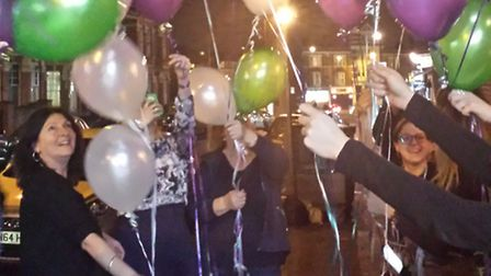 The Social owner, Annie Walshe, with customers launching balloons with the name of a woman who inspi