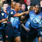 Sylvain Wiltord (centre) celebrates after putting Arsenal 2-0 up in theirFA Cup win at Old Trafford
