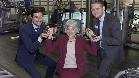 GLL's Joe Rham and Matt Perren help Cllr Janet Burgess try out new gym equipment at Cally Pool