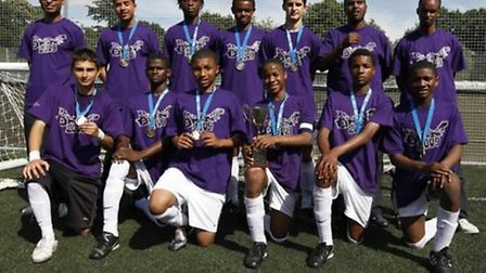 Raheem Sterling shows off the winners trophy at the 2009 London Youth Games with Brent (pic: London
